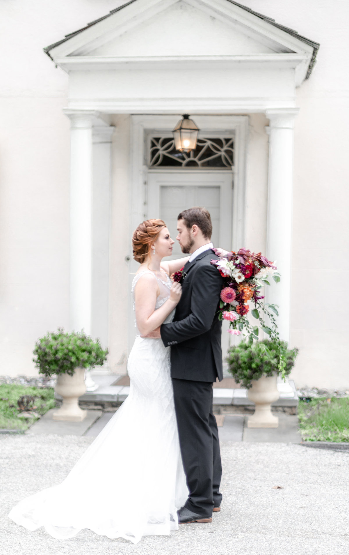 Wadsworth Mansion wedding with red headed bride and red burgundy white and greenery bouquet