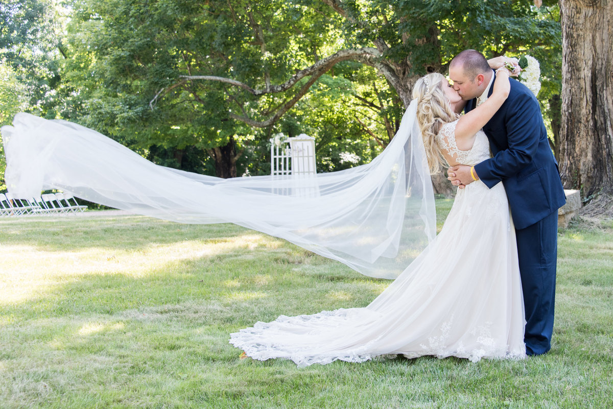 Southern bride and groom veil portrait at wedding in Lexington