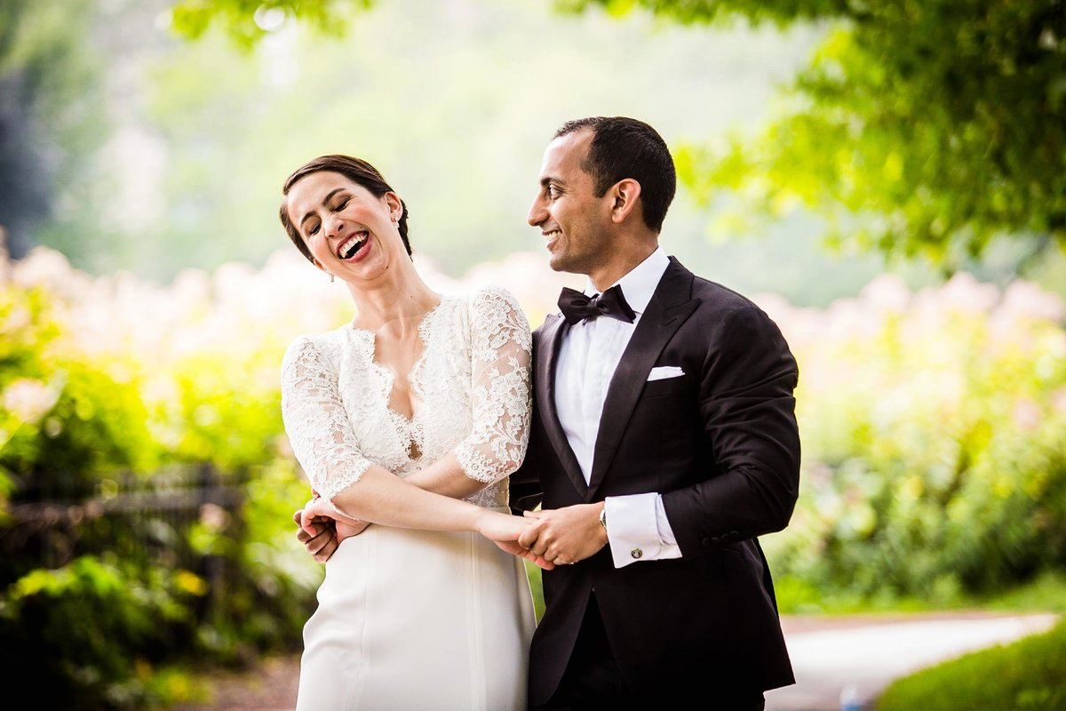 A couple laughs together during their Lincoln Park wedding portrait session.