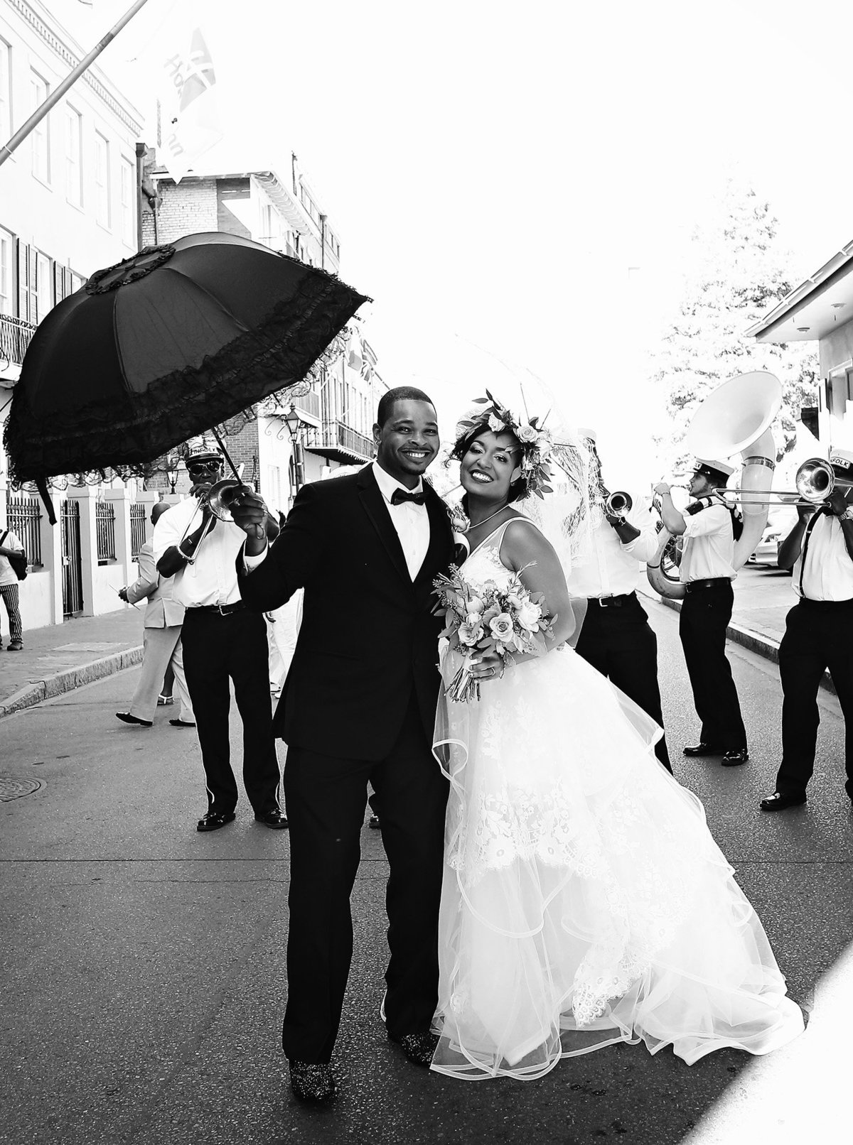 bride and groom in front of second line band