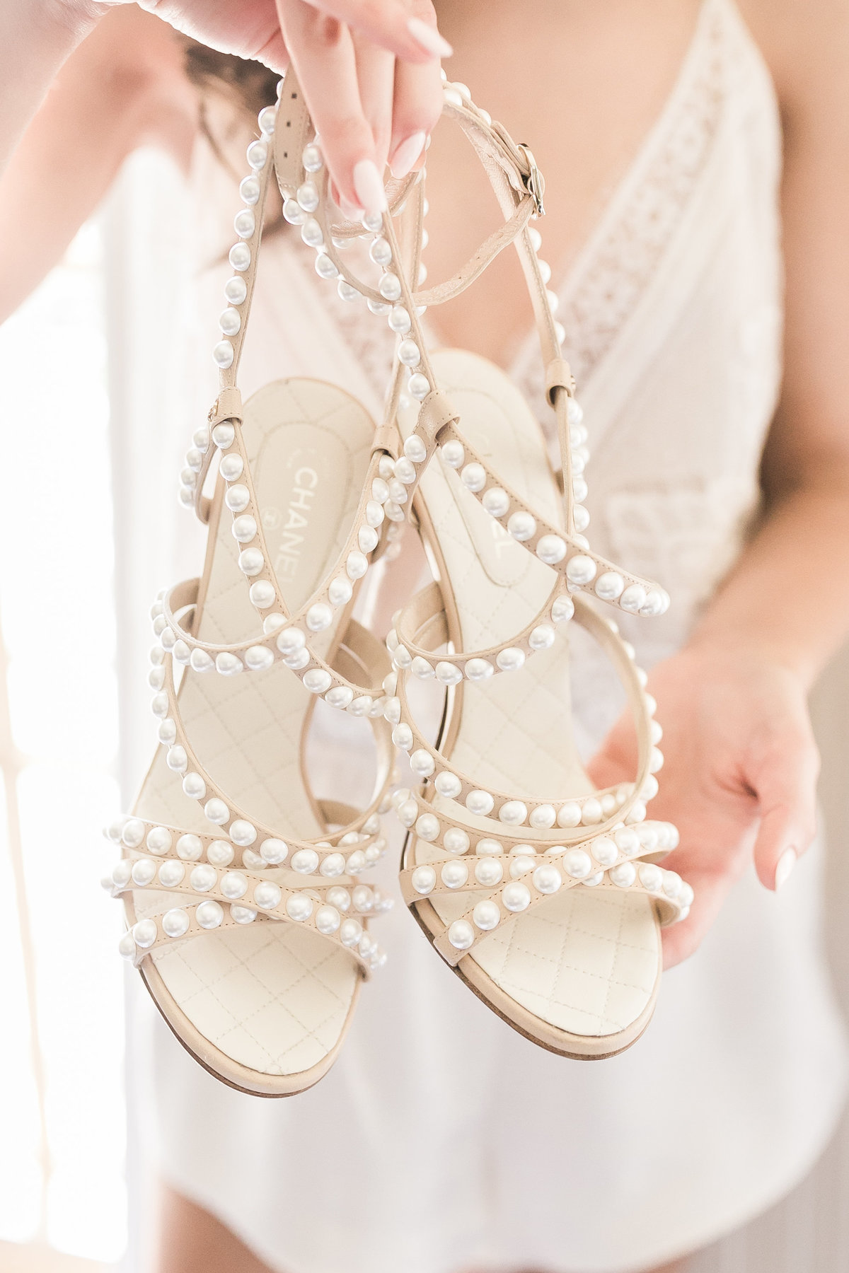 a photo of pearl chanel bride shoes for her wedding day at Green Valley Ranch Resort and Spa in Las Vegas