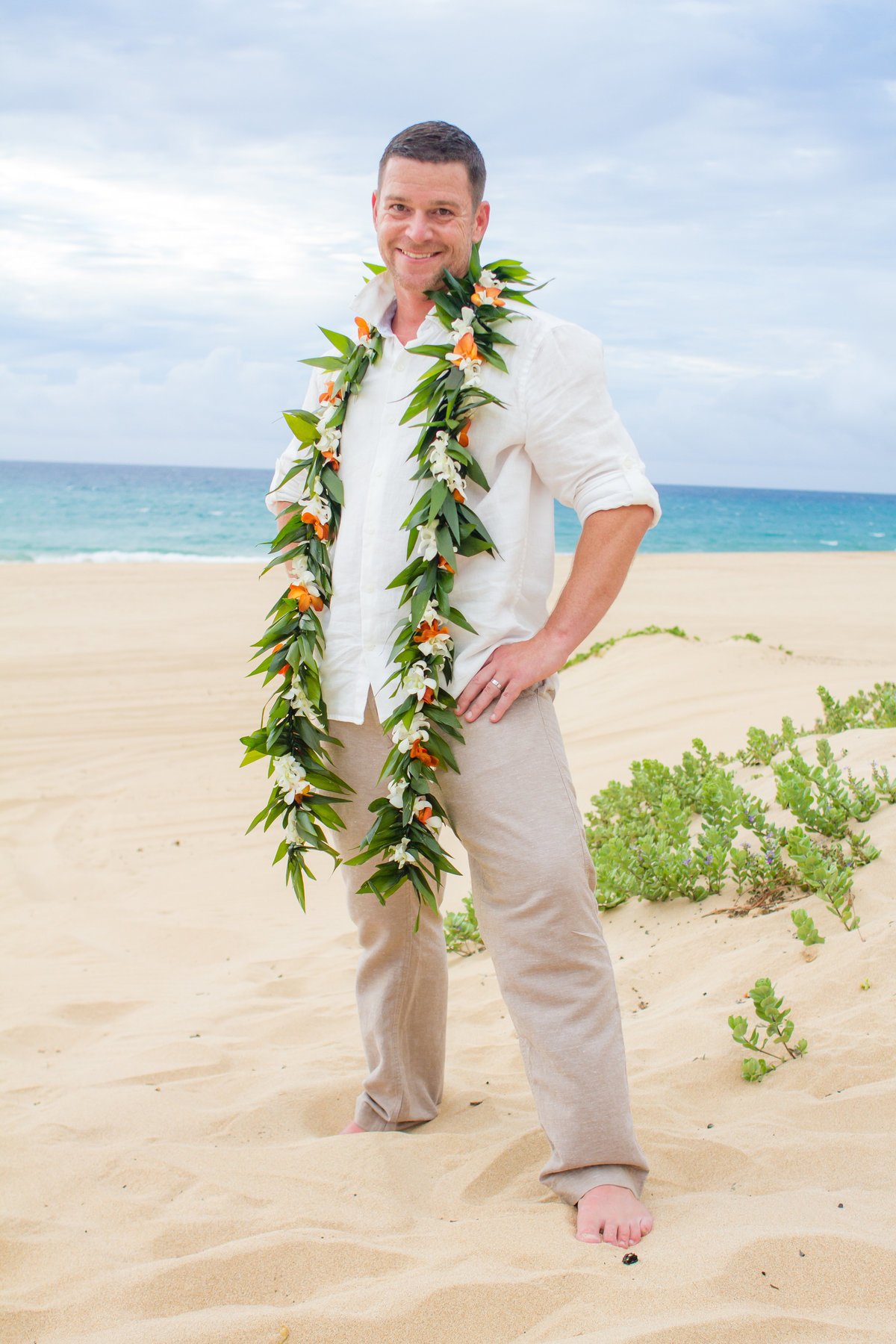 Groom wearing lei in Hawaii.
