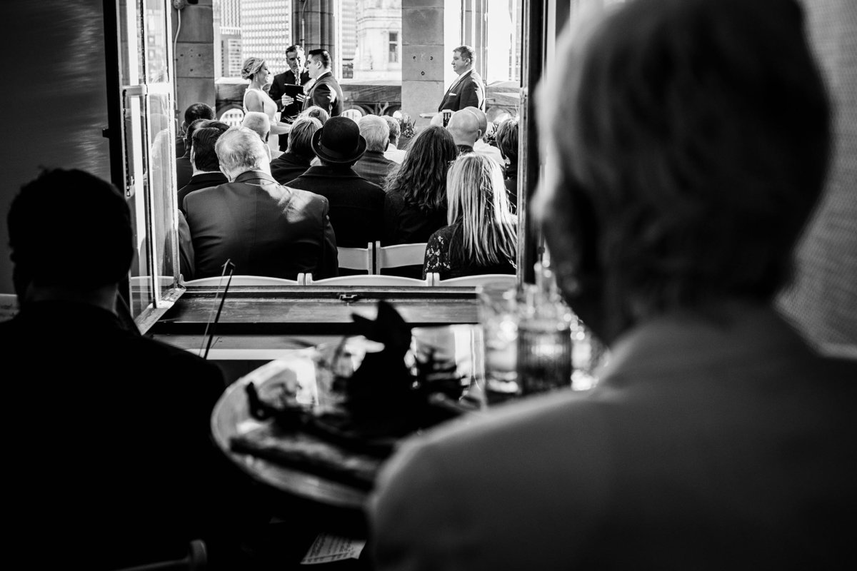 A guest watches a ceremony from inside the Tribune Tower during a wedding in Chicago.