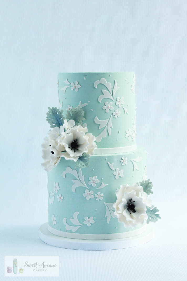 vintage blue wedding cake with lace and sugar anemones