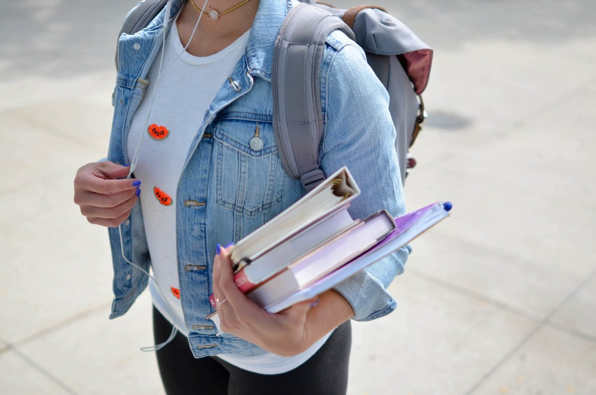 student_carrying_books-min