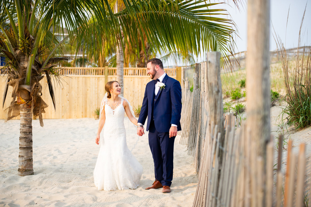 bride and groom in ceremony space on beach