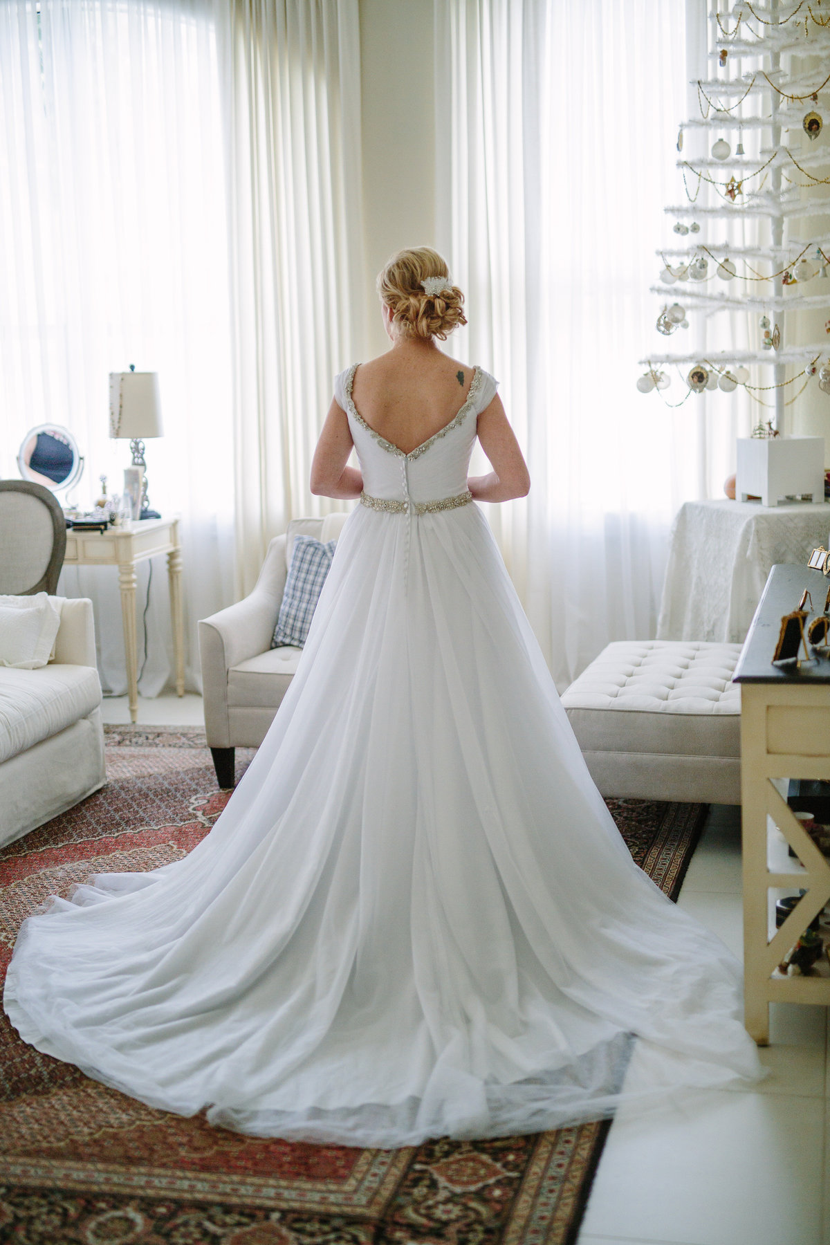 Back view of brides wedding gown after getting dressed for wedding ceremony.