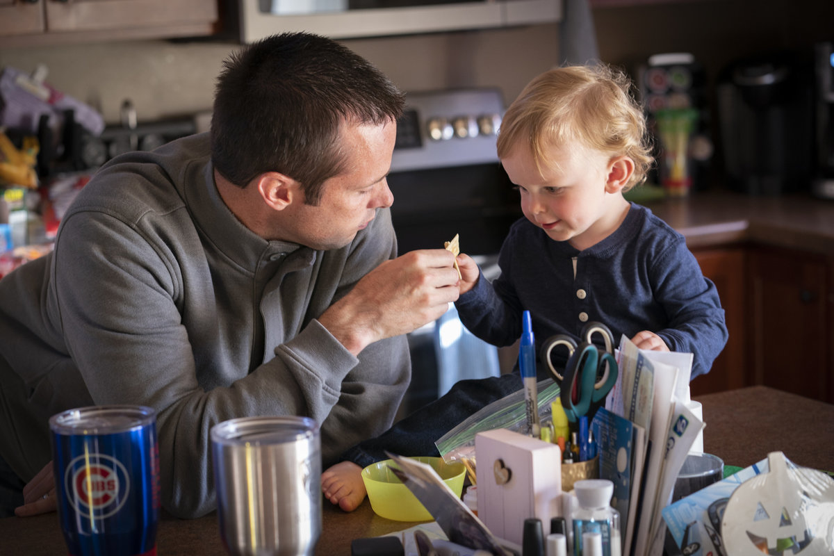sioux falls family photography in home session father and son in the kitchen south dakota