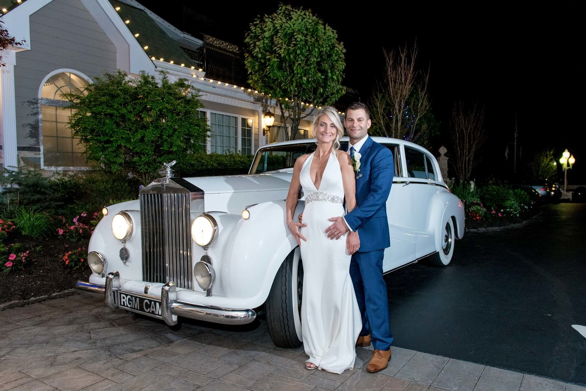 Bride and groom next to a vintage car Giorgio's Baiting Hollow