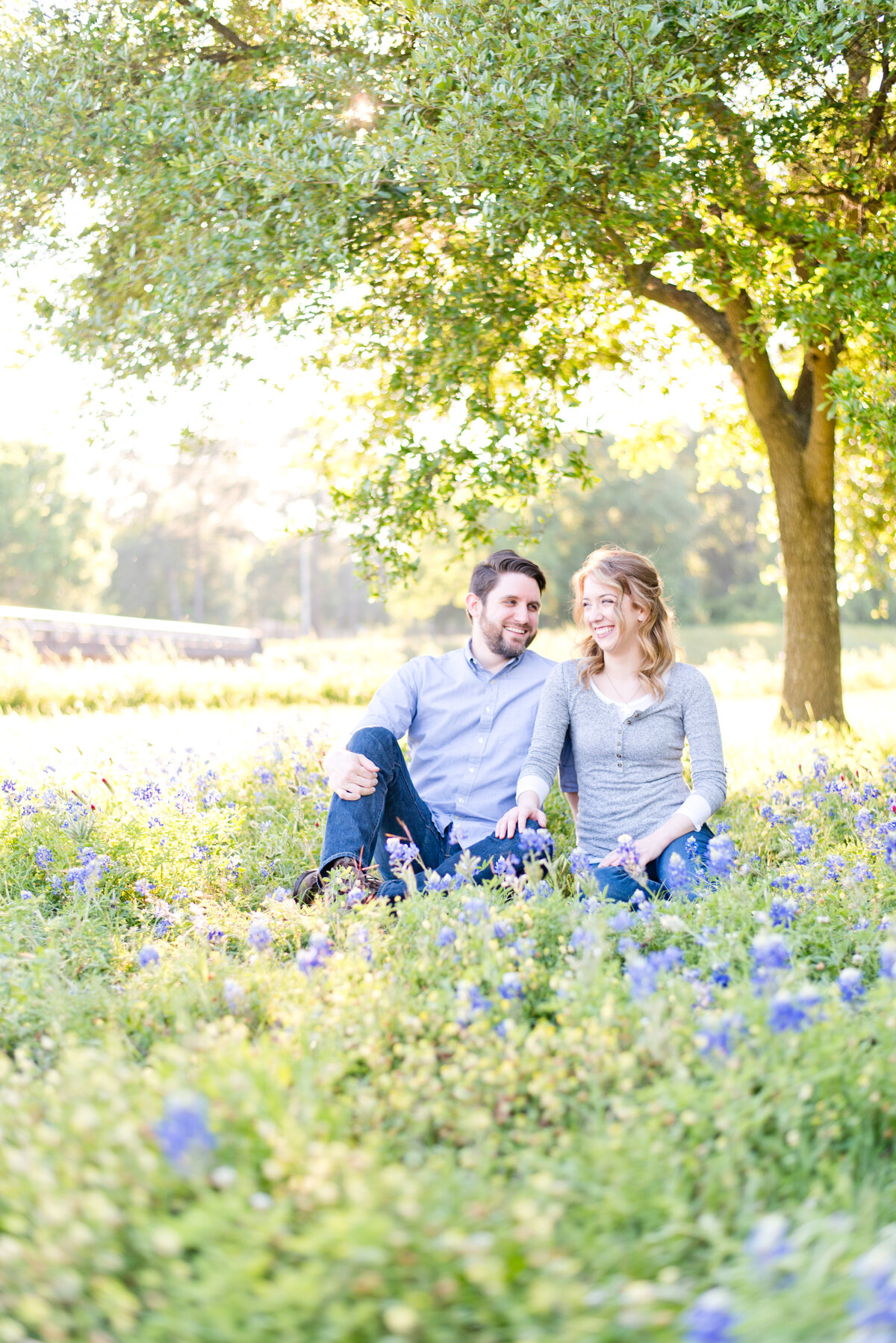 Fort Worth Engagement Photos of bride and groom in field