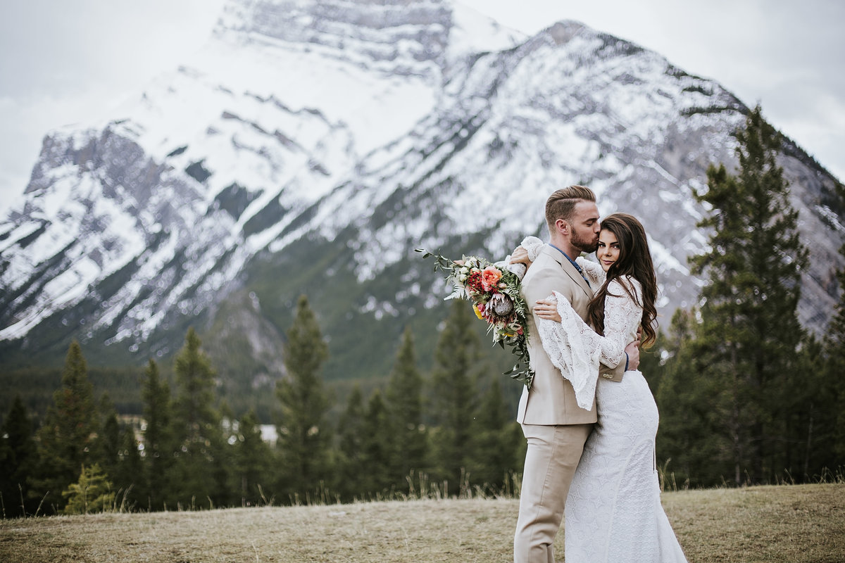 Adventure bride and groom at top of Buffalo Mountain Banff