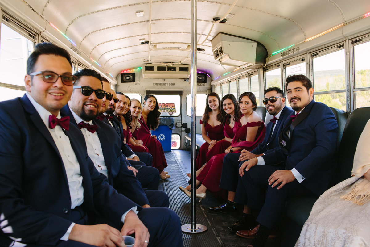 Bridal party ride party bus to ceremony as wedding transportation in hill country San Antonio at Oaks at Heavenly venue