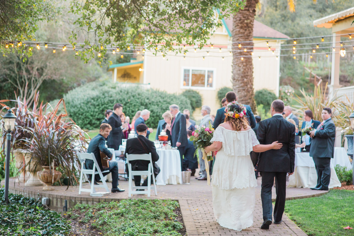 Bride and groom joining cocktail hour at Madrona Manor in Healdsburg California