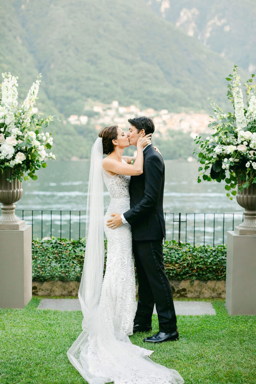 bride and groom first kiss at ceremony at Lake Como Wedding