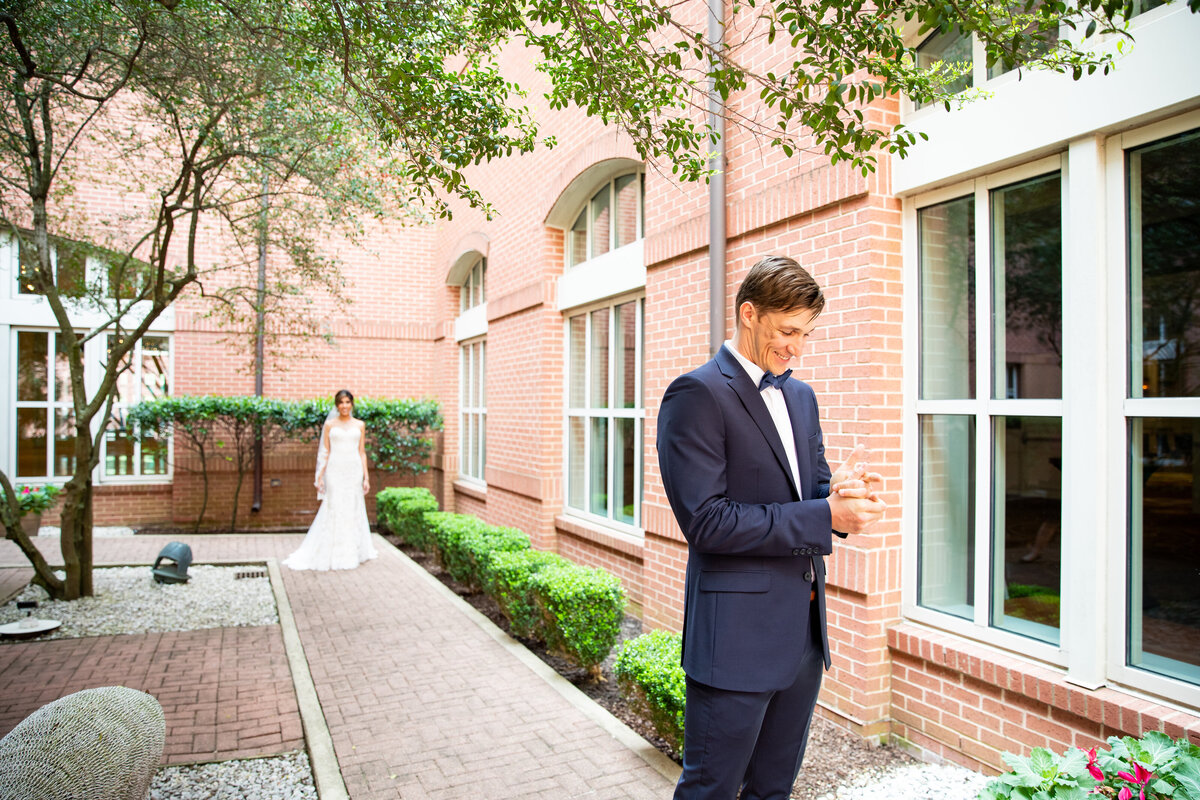 Bride and Groom's First Look in a Courtyard