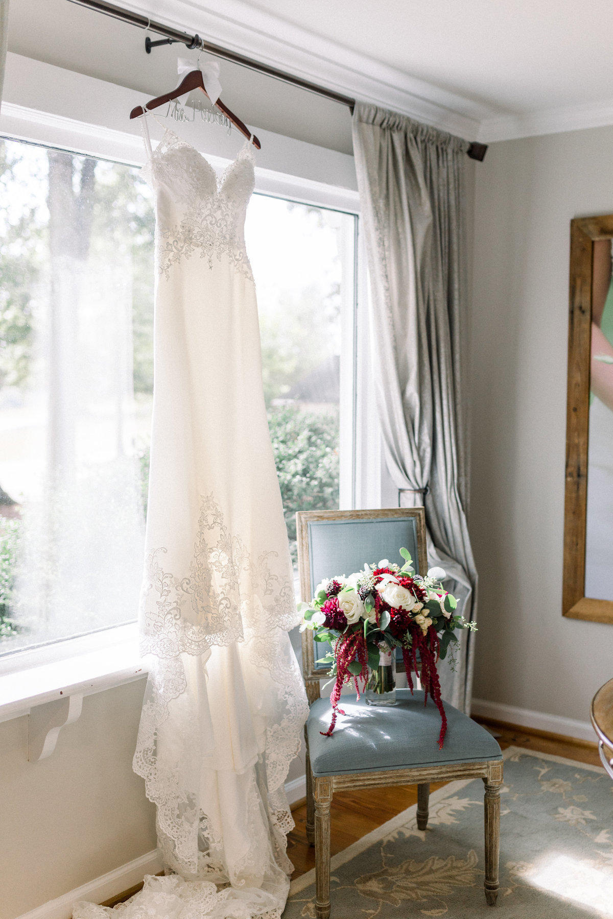 Washington DC Wedding Photography, brides dress hanging up in window