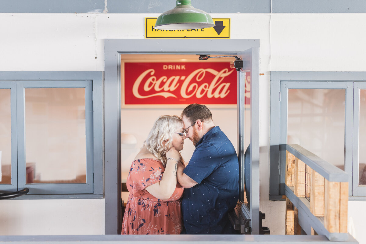 Engaged couple coca cola sign wildwood new jersey