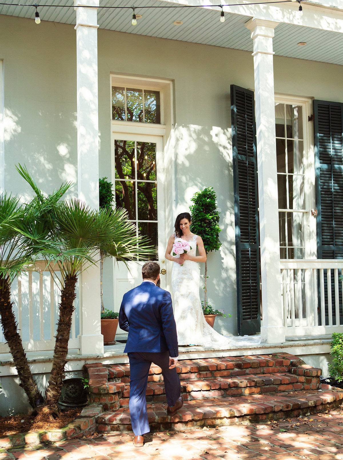 new orleans groom sees bride for first time on the porch of The Terrell House