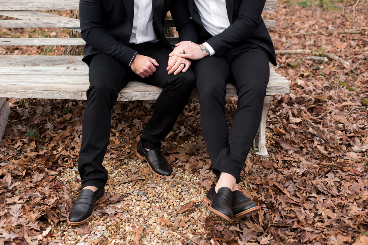 fashionable gay couple photographed outdoors on bench