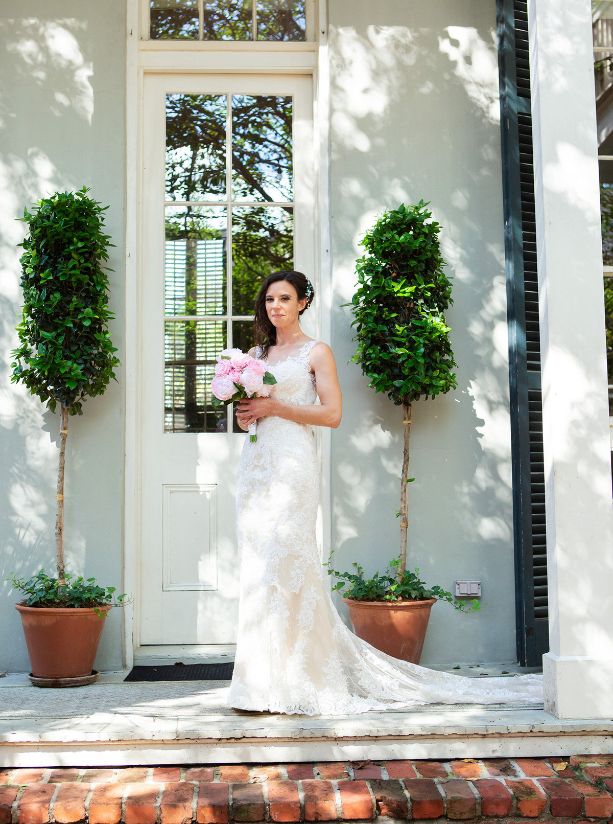 nola bride standing on the porch of The Terrell House