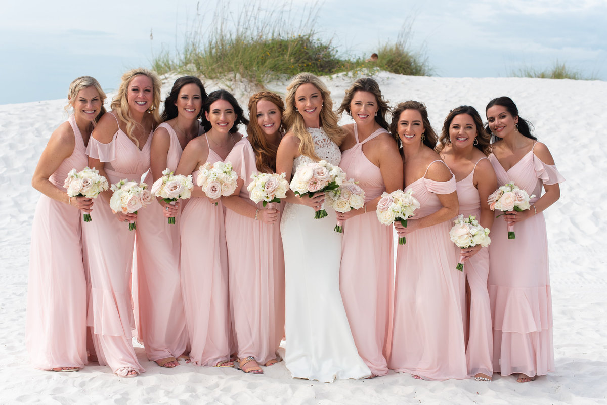 Blush and Gold Wedding at Hilton Clearwater Beach. bride tribe. bridal party. bridesmaids. tampa wedding planners. blush bridesmaid dresses.