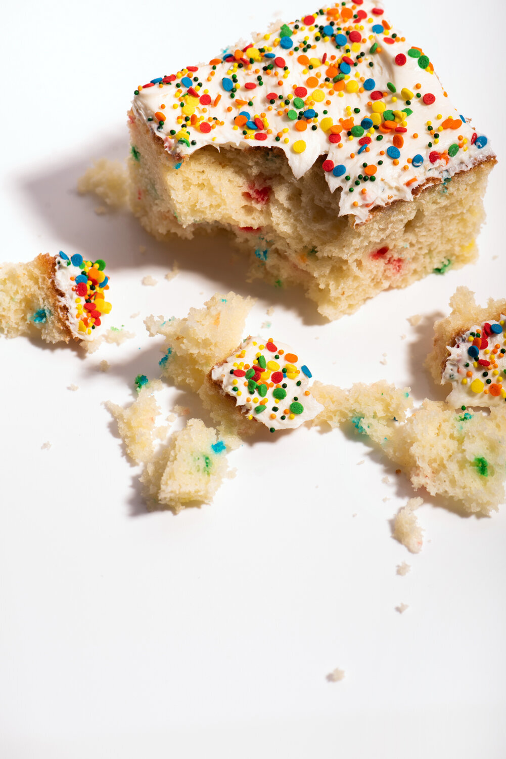 funfetti cake slice on white