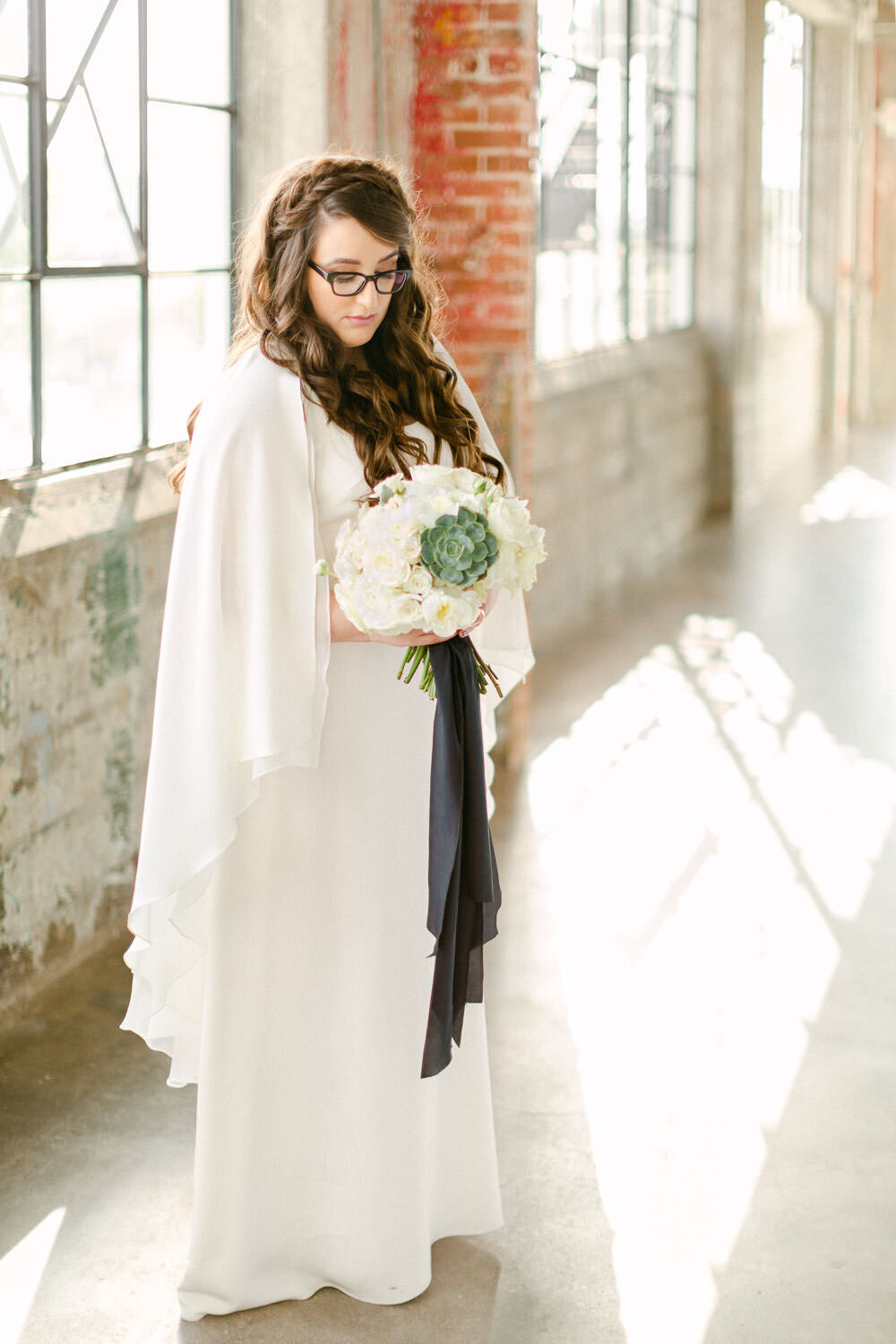 Intimate Houston Wedding bride photos in white cape wedding dress and bouquet