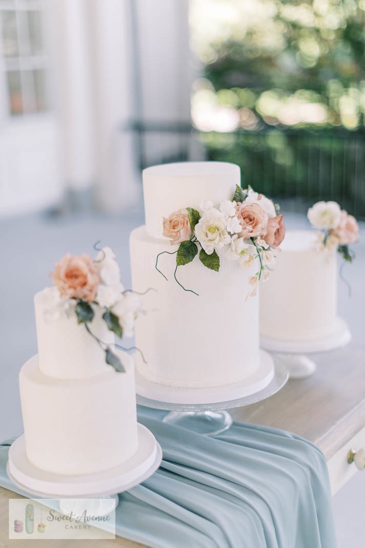 wedding cake trio in white with romantic flowers at La Salle Park, wedding cakes Burlington