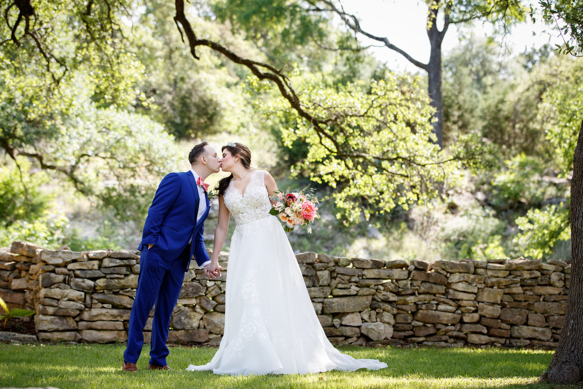 Austin wedding photographer addison grove wedding photographer bride groom kissing