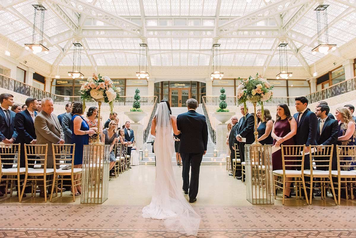 Bride walks down the aisle at the Rookery in Chicago