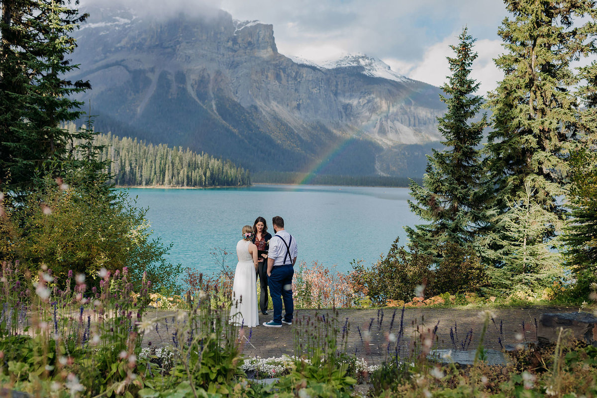 rainbow over elopement wedding ceremony viewpoint emerald lake lodge