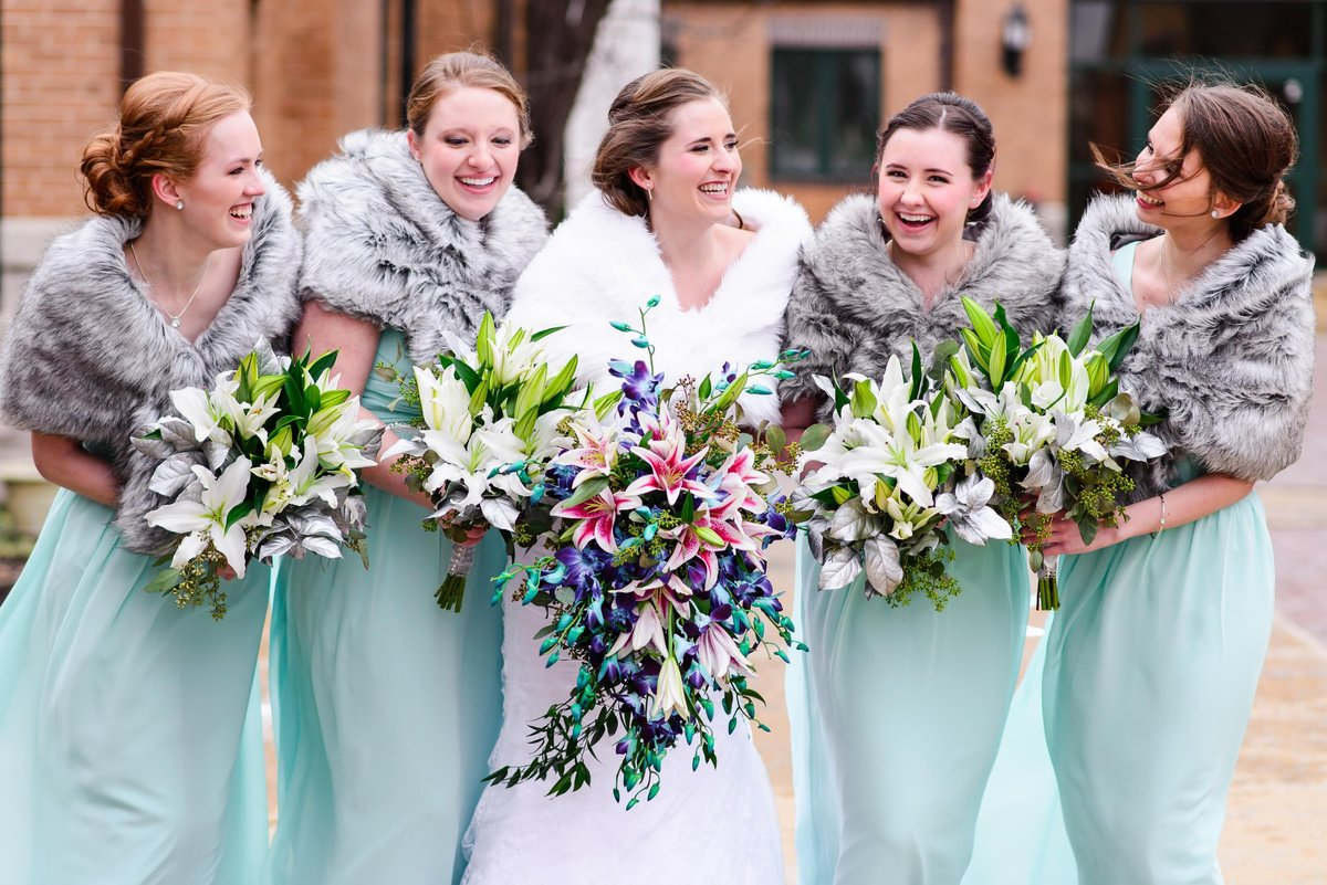 Bridal party portraits outdoors in the snow with big bouquets