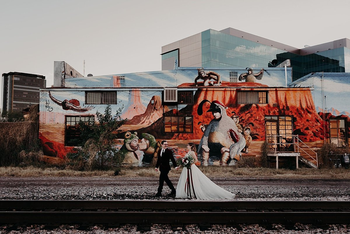 Bride and Groom elope and take photos along a mural and train tracks in Tucson Arizona