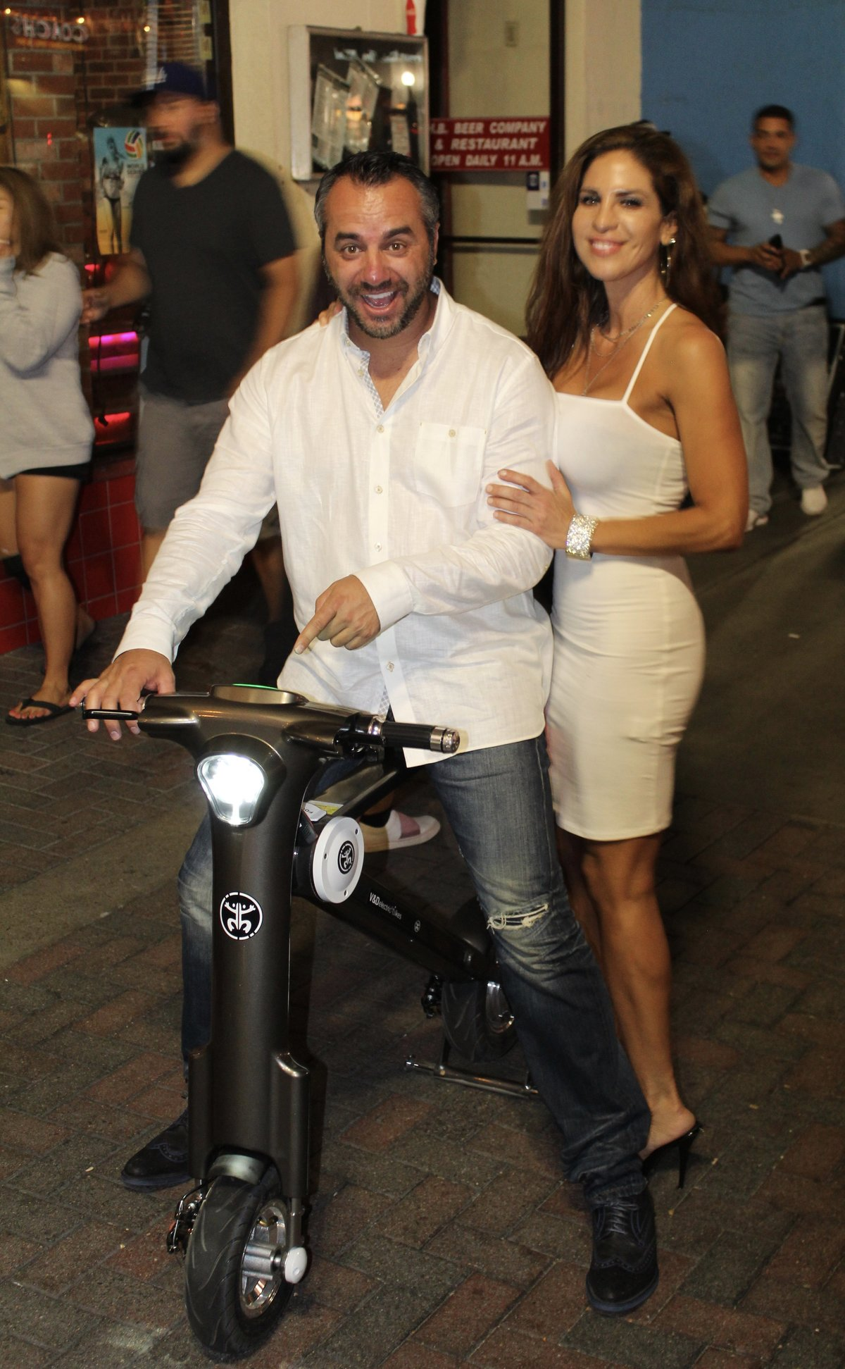 Couple dressed in white on Go-Bike M1
