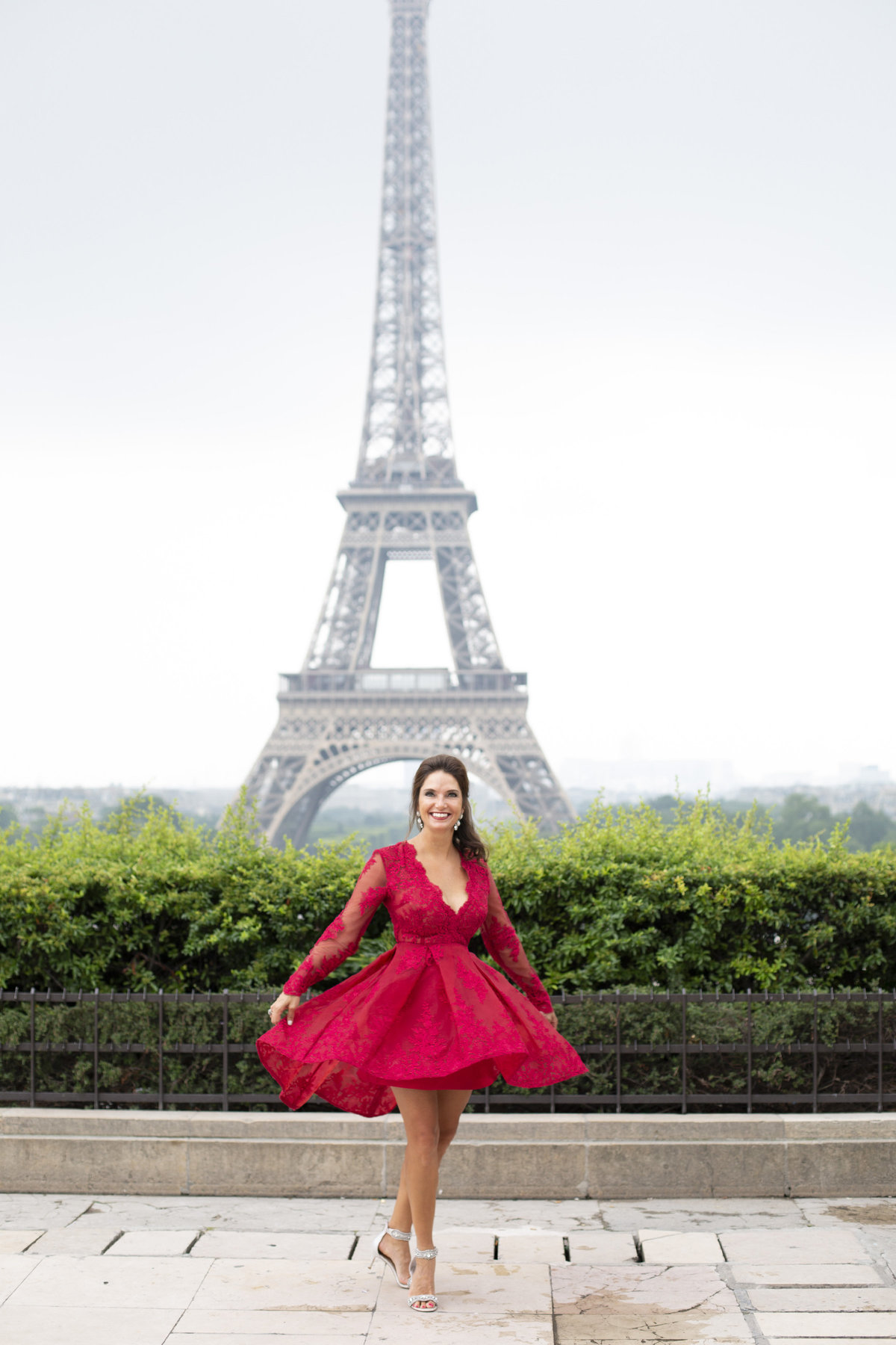 Beautiful woman in red dress spins in front of Eiffel Tower 49