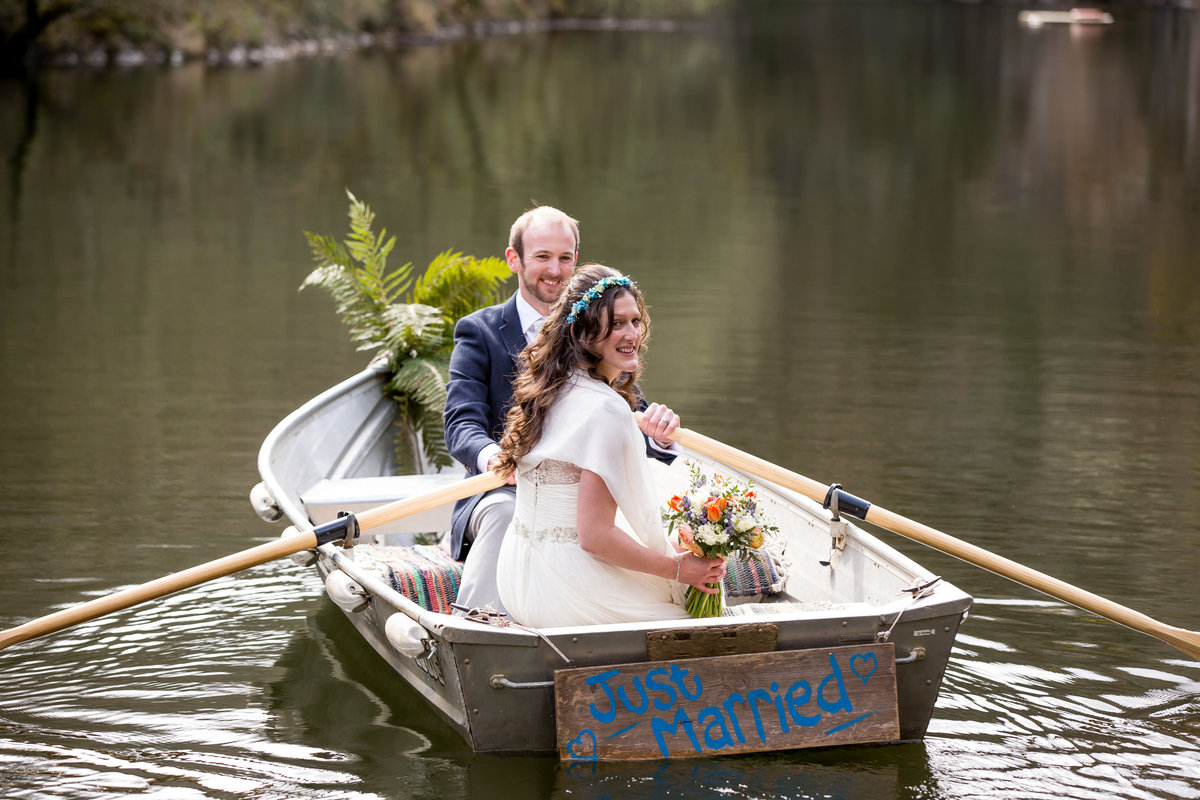 bride and groom in boat wedding cornwall