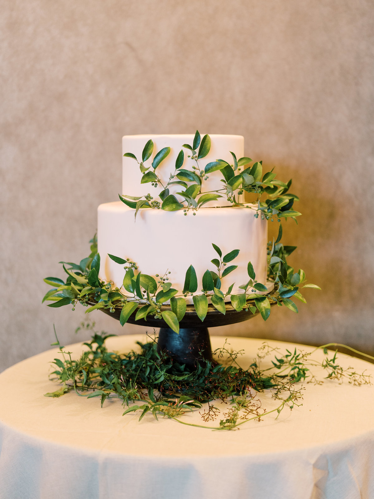 a garden themed cake surrounded by greenery vines at a wedding at Red Rock Casino in Las Vegas