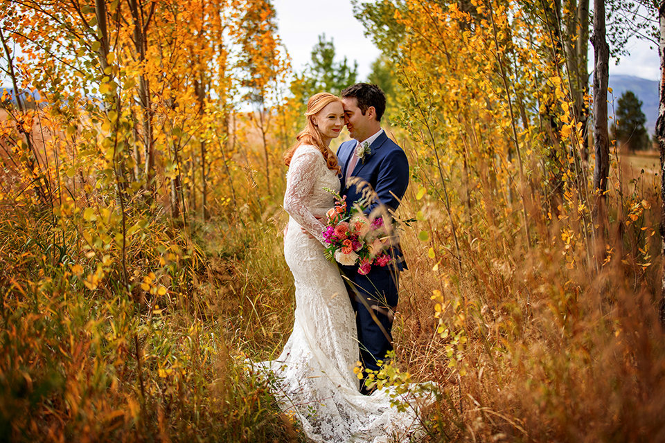 Granby-Colorado-Strawberry-Creek-Ranch-Wedding-Fire-on-the-Mountain-Wedding-Pops-of-Color-Fire-hot-colors-yellow-aspen-leaves-first-look