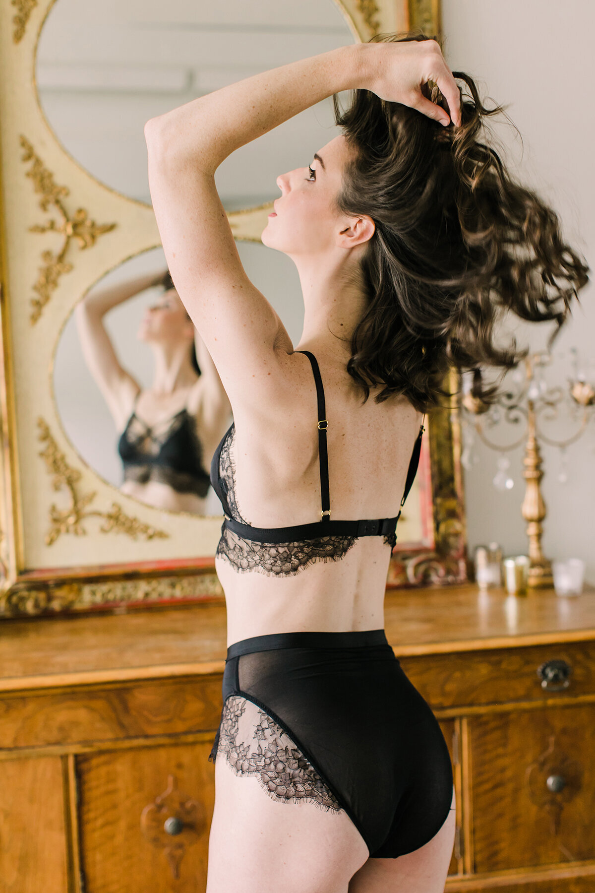A very elegant and romantic boudoir photo with a mirror reflection
