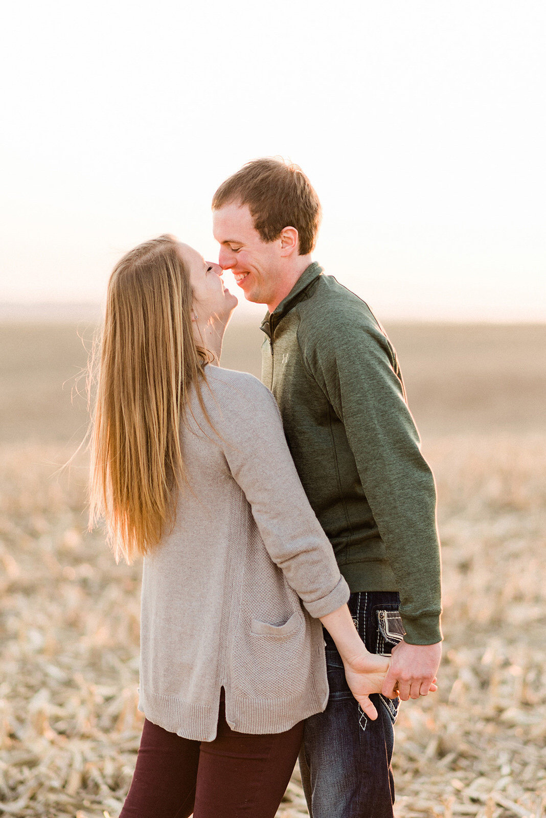 Nicole Corrine Iowa Wwdding Photographer Farm Engagement Session nose kiss
