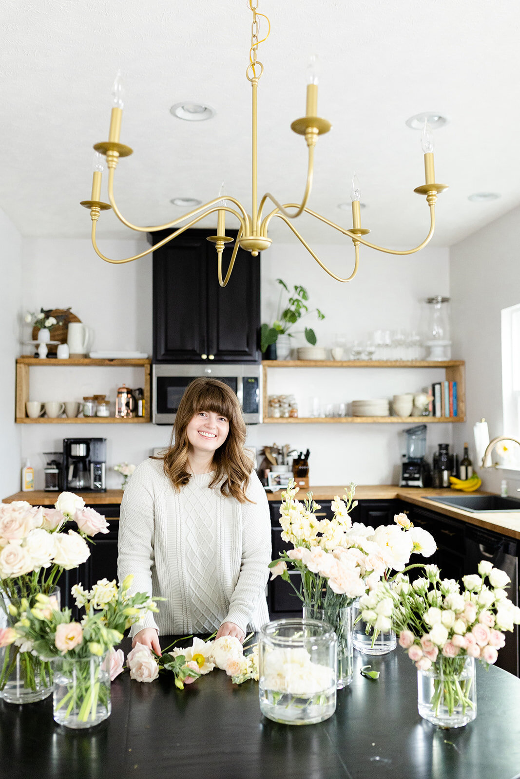 Florist standing with flowers for brand photos