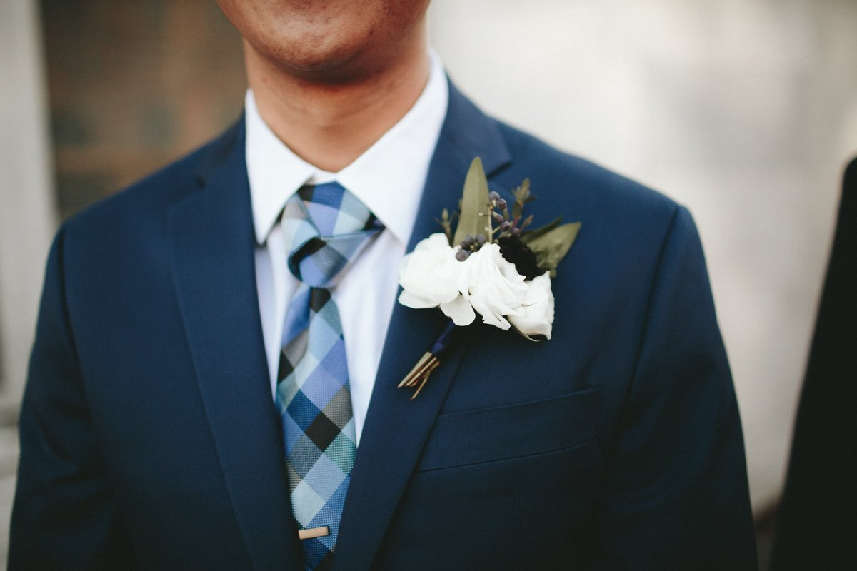 winter white and blue boutonniere