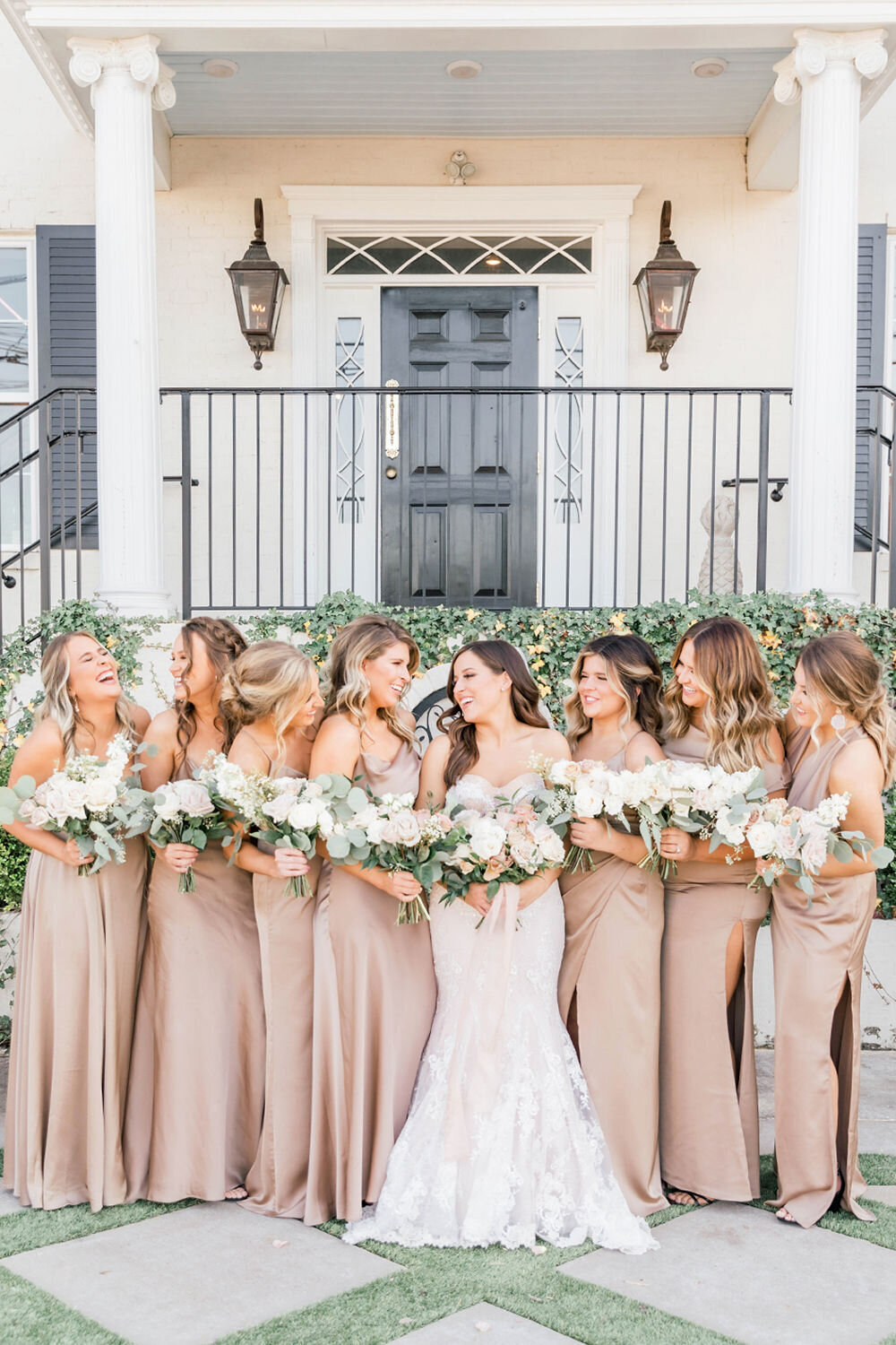 Light and airy bridesmaids posed for wedding photographer: Paige Michelle Photography outside wedding venue, The Charleston in Bowling Green, KY