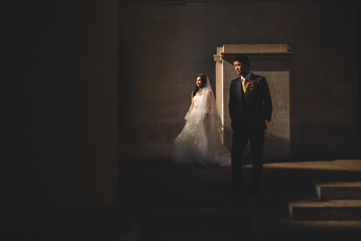 creative wedding photo of couple in harsh sunlight