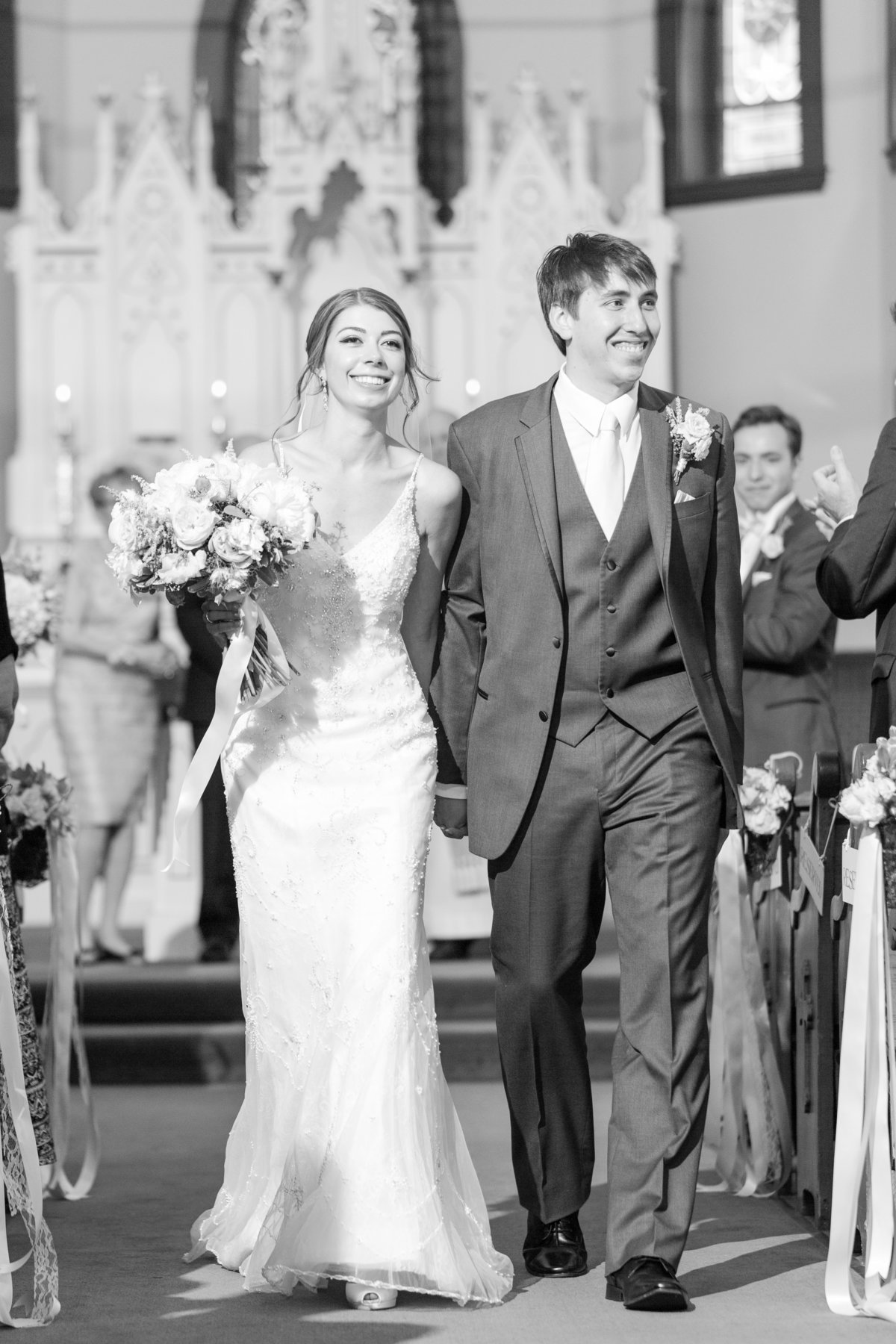 Bride and groom walking back down aisle after wedding ceremony