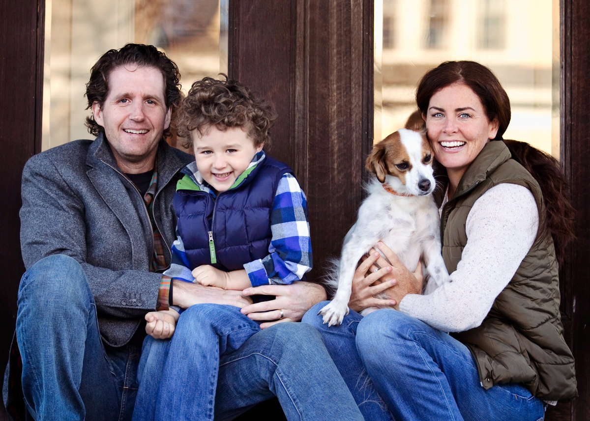 A family poses at home for CT photographer Karissa Van Tassel