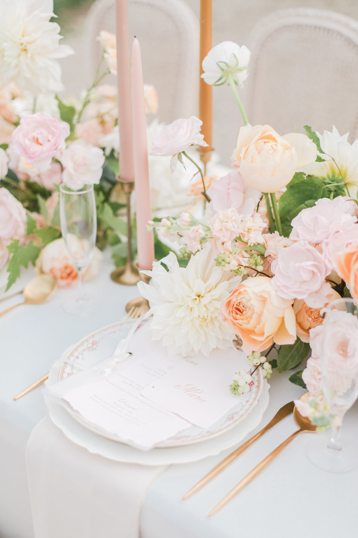 orange blush ivory and gold wedding tablescape at champagne france wedding by costola photography