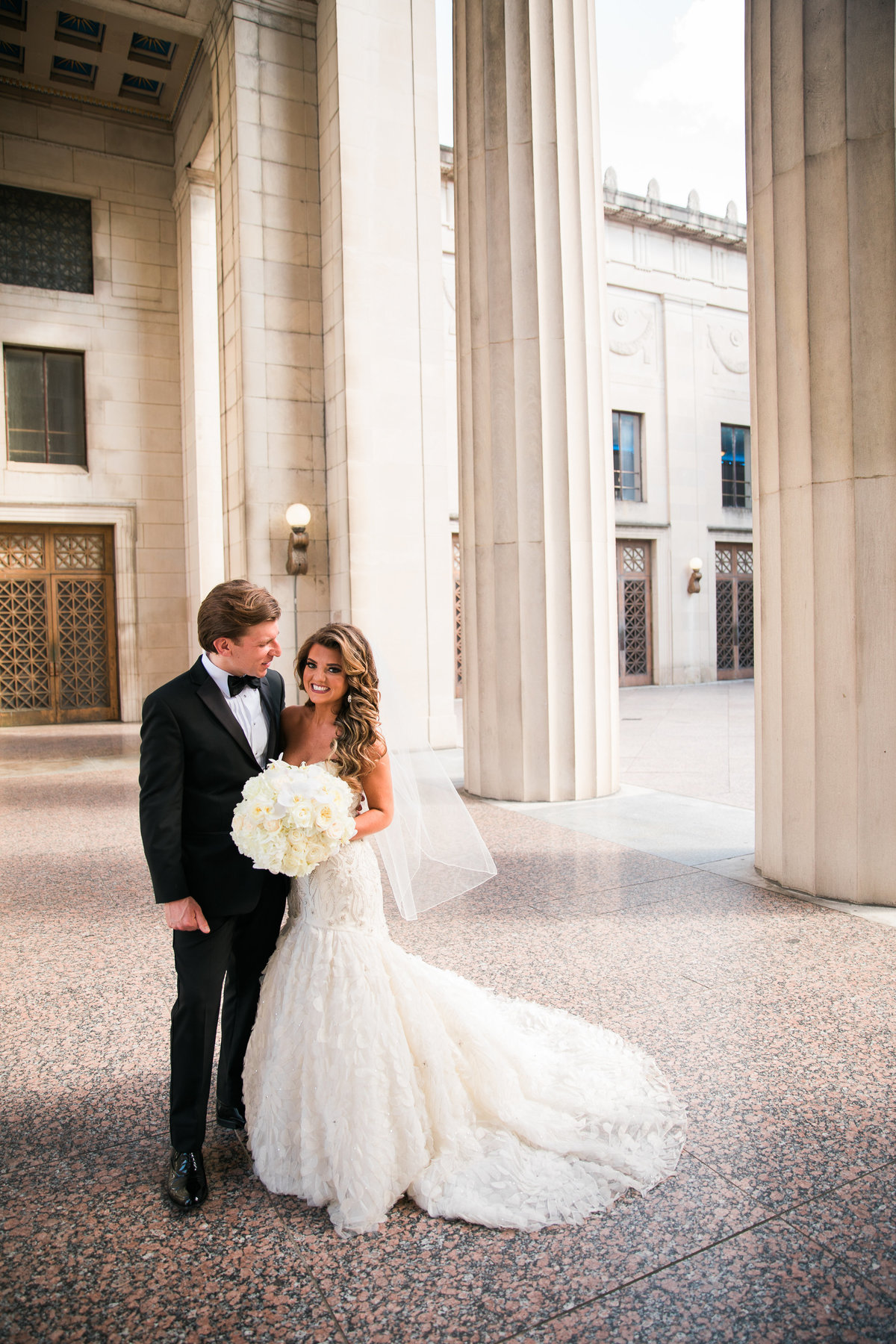 Bride and Groom in the columns at War Memorial in Nashville.