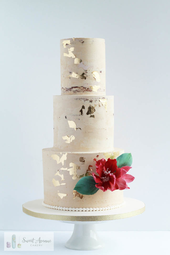 semi naked buttercream cake with gold leaf and burgundy flowers