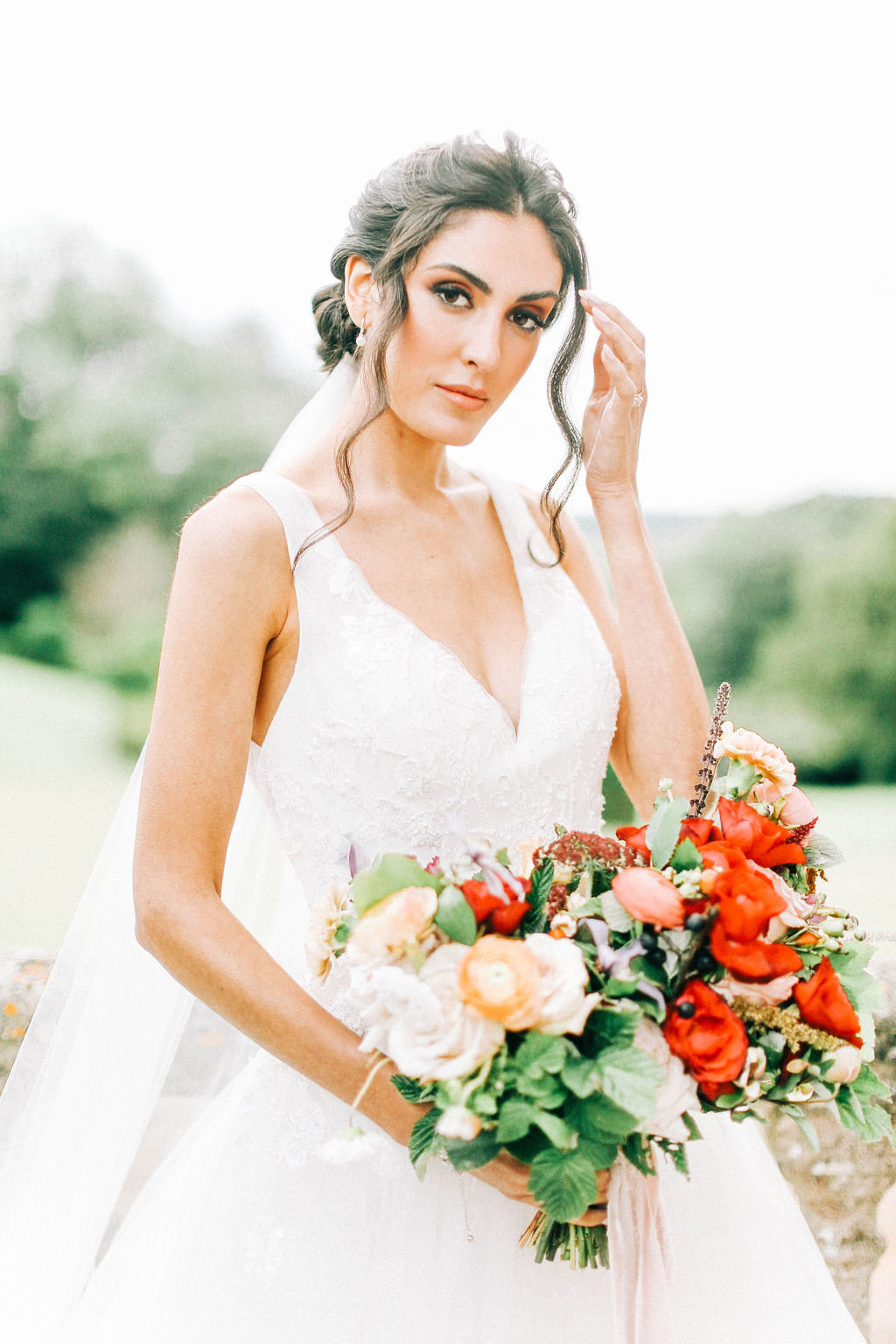 V Neck Wedding Gown, Elegant Bridal Updo and Red Bridal Bouquet